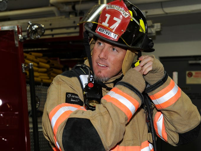 Detroit Tigers pitcher Joe Nathan puts on firefighting