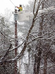 A crew from J.W. Didado in Ohio helps JCP&L by working on power lines on Tempe Wick Road in Harding on March 7, as wicked winter weather was expected to pick up within the next few hours.