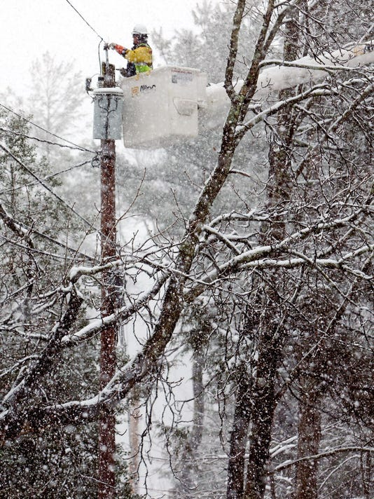 Lineman works in Harding during snow