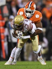 Clemson linebacker Dorian O'Daniel (6) brings down Florida State wide receiver D.J. Matthews (29) during the 3rd quarter on Saturday, November 11, 2017 at Clemson's Memorial Stadium.