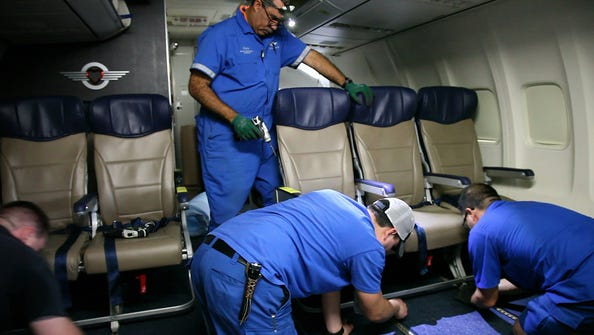 Southwest Airlines aircraft technicians install newer, skinnier seats on a 737 at the carrier's headquarters in Dallas on Sept. 23, 2013.