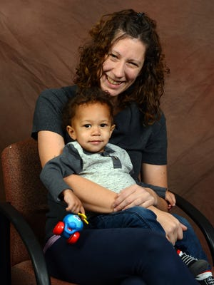 House of Hope graduate Kim Insley and her son Ezekiel Insley December 2, 2014.