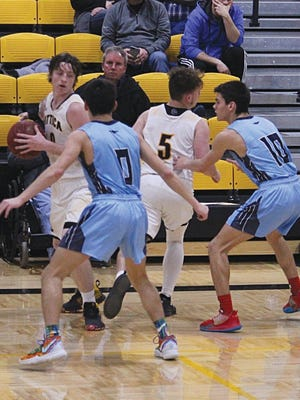 Skyline High School's Fisher twins, Sam and Steve, combine for a defensive force to be reckoned with during basketball competitions so far this year.