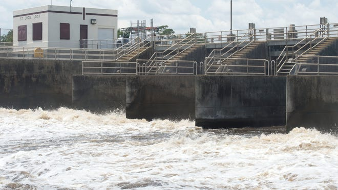 Water from Lake Okeechobee is released June 16, 2016, into the C-44 Canal, which leads to the St. Lucie River, at the St. Lucie Lock and Dam near Stuart.