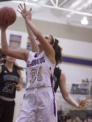 Grace Wallace of Fowlerville makes this shot in the