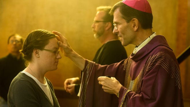 Bishop Michael Sis places an ash cross on a forehead during an Ash Wednesday service at McMurry University in 2017. Sis later led an evening service at Abilene Christian University. He will add Hardin-Simmons to his Abilene visit next week.