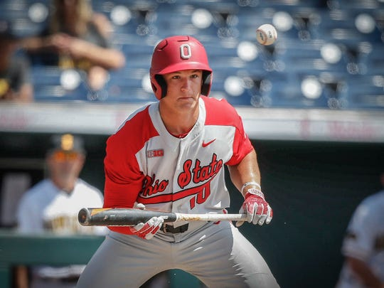 Ohio State freshman Dillon Dingler watches the ball after dropping a bunt down against Iowa during the Big 10 Baseball Tournament on Thursday, May 24, 2018, in Omaha, Neb.