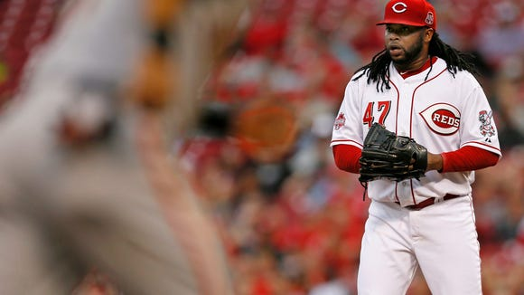 Reds starting pitcher Johnny Cueto looks to umpire