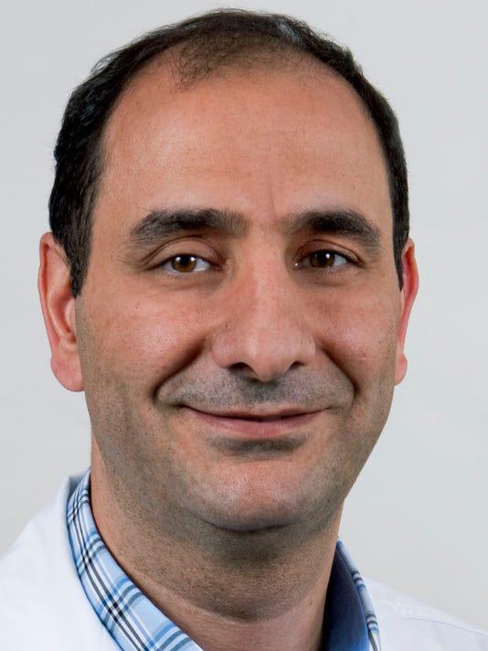 Dr. Ayman Jamal