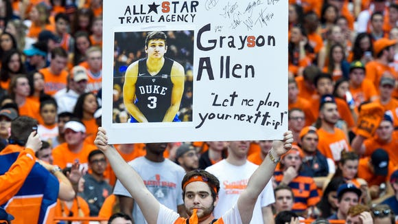 Feb 22, 2017; Syracuse, NY, USA; A Syracuse Orange fan holds a sign for Duke Blue Devils guard Grayson Allen (not pictured) prior to the game at the Carrier Dome. Mandatory Credit: Rich Barnes-USA TODAY Sports ORG XMIT: USATSI-336548 ORIG FILE ID: 20170222_pjc_ai8_697.JPG