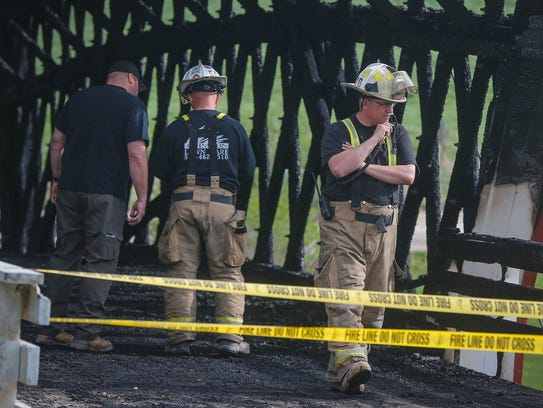 Officials in Madison County, Iowa, investigate a fire