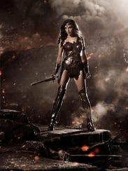 Gal Gadot brandishes her sword as Wonder Woman in 'Batman