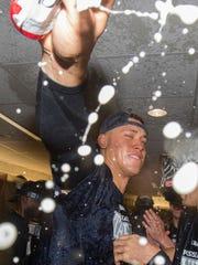 New York Yankees' Aaron Judge celebrates in the locker