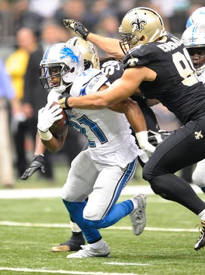 Ameer Abdullah tries to break free during the second quarter Monday night.
