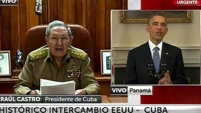 This screen shot taken from live video from the TN channel shows President Barack Obama, right, and Cuba's President Raul Castro addressing their nations at the same time, from Washington D.C. and Havana, on Wednesday, Dec. 17, 2014. Obama announced the re-establishment of diplomatic relations as well as an easing in economic and travel restrictions on Cuba Wednesday.