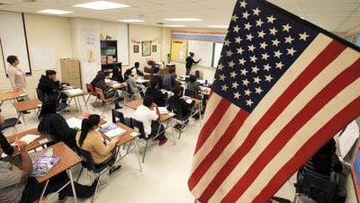 International students work in class at Iroquois High School. March 10, 2015