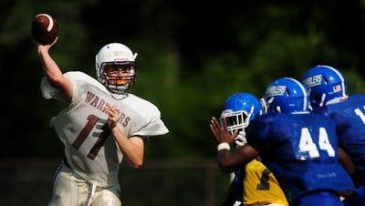 Watchung Hills quarterback Mark Ball led his team over Hillsborough on Friday.