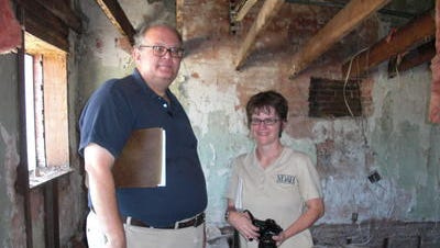 William M. Gatlin and Jennifer V.O. Baughn of the Mississippi Department of Archives and History visited the Lumberton Museum to offer guidance for the restoration of the museum after termite damage.