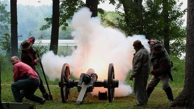 Confederate Civil War reenactors of 'Pelham's Battery of the Army of Northern Virginia' fire a cannon as Mosinee celebrated pioneers of north-central Wisconsin with its annual summer festival Little Bull Falls LogJam in 2013