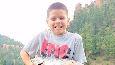 Cody McDowell, 10 of Albuquerque, caught this 21-inch rainbow trout at Seven Springs Brood Pond on Aug. 21.