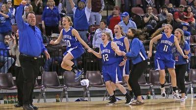 Fairfield celebrates the State B girls' basketball championship Saturday at Metra.