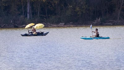 Outdoor enthusiasts took advantage of the warm weather to paddle around Eagle Creek Reservoir Monday, Sept. 25, 2017. The warm weather and lack of wind was a kayaker's dream day on the reservoir.