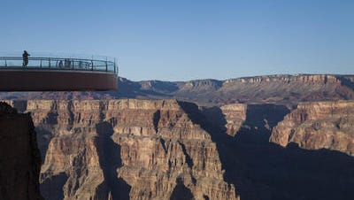 Tourists can take in views of the Grand Canyon, one of Arizona's largest tourism attractions,  from the Skywalk.