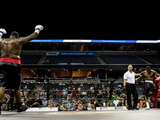 """Grover Young of Memphis, left, celebrates after defeating Javonta Charles during the American Boxing Federation's """"The Big Payback"""" Saturday night at FedExForum."""