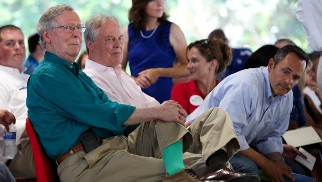 (L-R)  Sen. Mitch McConnell, Rep. Ed Whitfield and Republican gubernatorial candidate Matt Bevin listened to the emcee during the Fancy Farm picnic.Aug. 1, 2015