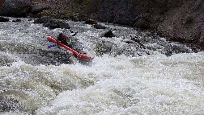 Videographer Jason Bean negotiates the Bronco-Jaws segment of rapids on the Truckee River.
