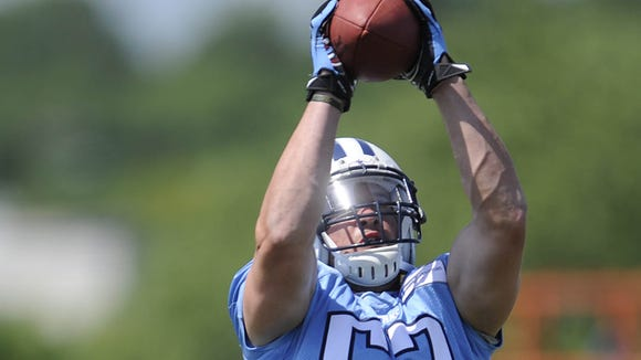 Linebacker Colin McCarthy catches a pass during the Titans'  final practice of minicamp on June 19, 2014.