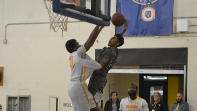 Rasheide Bell dunks during a game for South Suburban. He's a Central graduate.