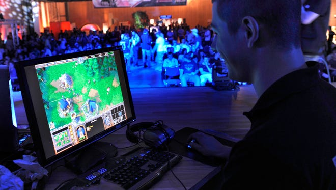 A participant competes in the Electronic Sports League in Dresden, Germany.