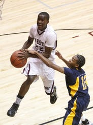 West Creek's Zavion Williams gets fouled by Northeast's