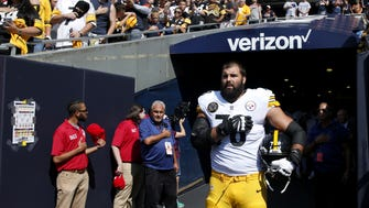 Alejandro Villanueva of the Pittsburgh Steelers stands by himself in the tunnel for the national anthem prior to the game against the Chicago Bears at Soldier Field. Villanueva, a former Army Ranger and graduate of West Point, visibly stood outside the tunnel at Soldier Field with his hand over his heart during The Star-Spangled Banner while his teammates remained under cover inside the stadium.