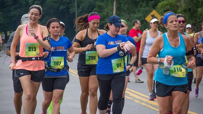A group of women head out at the start of the SummerFest 12K at Mendon Ponds Park on Aug. 31, 2013.