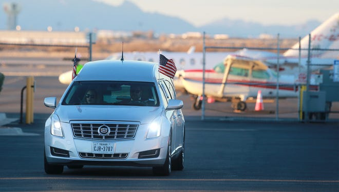 The hearse which transported Supreme Court Justice Antonin Scalia's body to the airport from Sunset Funeral Home departs the Atlantic Aviation hangar at El Paso International Airport on Sunday. Scalia's body was flown back to Virginia.