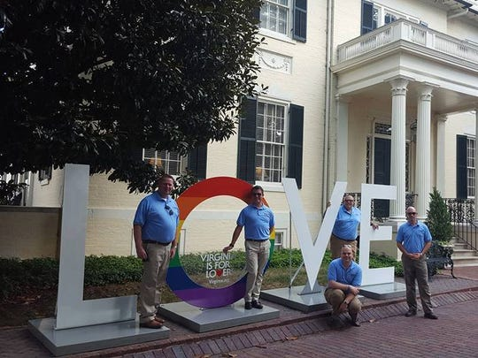 Shenandoah Valley Pride Alliance stand in front of