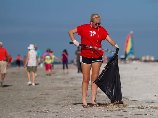 Maya Kaiser helps clean Fort Myers Beach on Saturday