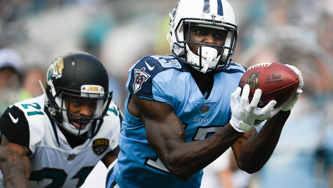 Titans wide receiver Taywan Taylor (13) pulls in a 42-yard catch over Jaguars cornerback A.J. Bouye (21) during the third quarter Sunday, Sept. 17, 2017, at EverBank Field.