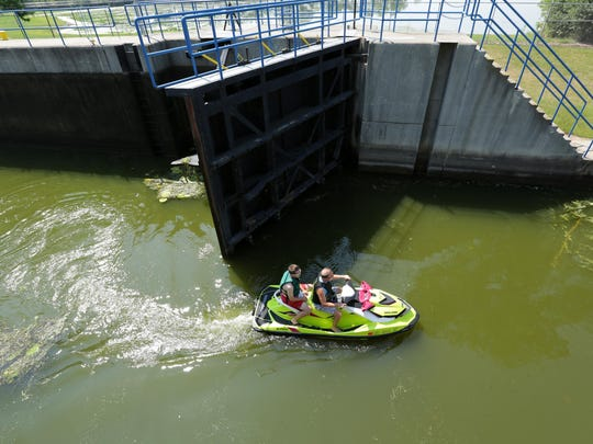 The Menasha Lock stays busy as boats and other watercraft pass through on a recent Saturday.