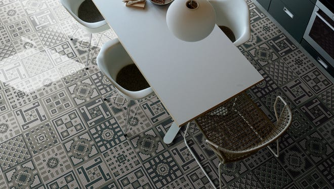 This undated photo provided by Appiani shows a Memorie mosaic tile floor in a kitchen, which puts a contemporary spin on traditional motifs. (Gaelle Le Boulicaut/Appiani via AP)