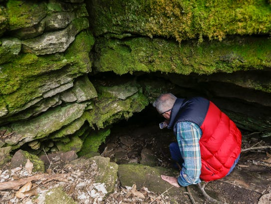 Dr. Gil Mobley descends into the cave near Wanda Gray Elementary School on Wednesday.