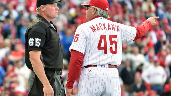 Phillies manager Pete Mackanin questions the infield fly call with umpire Ted Barrett during the sixth inning Monday against the San Diego Padres on Opening Day at Citizens Bank Park.