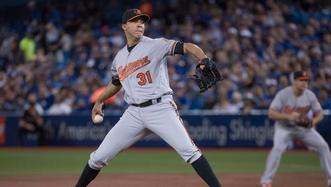 Orioles starting pitcher Ubaldo Jimenez (31) throws during the first inning against the Blue Jays.
