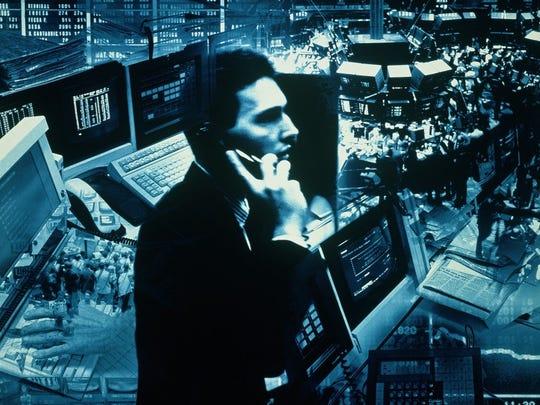 Stock market trader on trading floor.