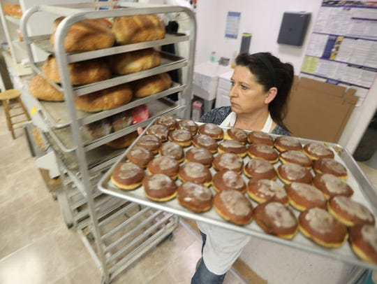 Jola Jasionek is shown with paczki or doughnuts filled
