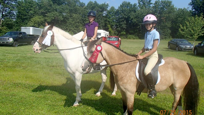 The Adams County 4-H Fun Horse Show is set for July 9, beginning at 9 a.m. at the Gettysburg Riding Club, 102 Hounds Run Road, Gettysburg. Faith and Hope Null are shown on their horses at the 2015 4-H Fun Horse Show.