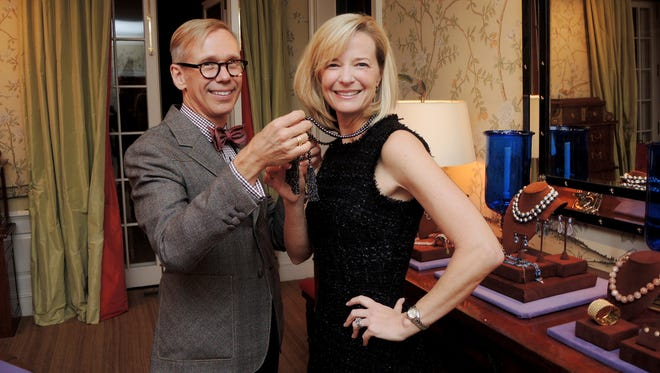 Swan Ball 2017 Jeweler Mish, assists Dallas Wilt with a black diamond necklace, during the Swan Ball 2017 Unveiling, held at the home of Julie and Tommy Frist.