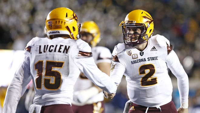 Arizona State wide receiver Devin Lucien (15) gets a hand-shake from Mike Bercovici after they hooked-up on a touchdown pass-play against Cal in the first half on Nov. 28, 2015 in Berkeley, Calif.
